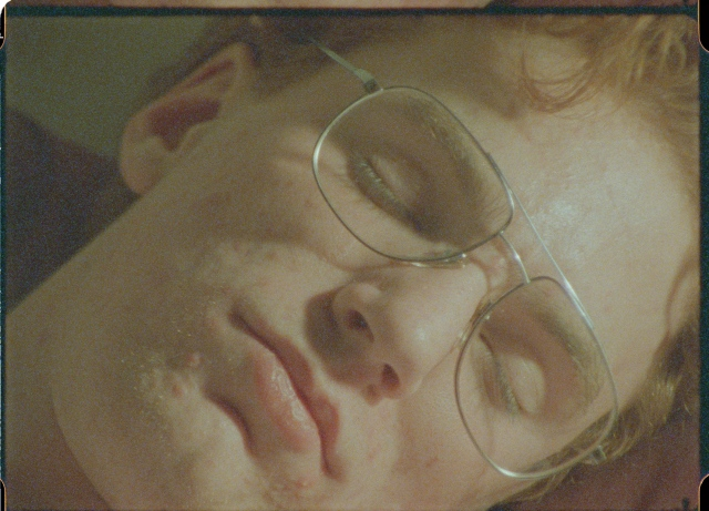 a still from PAUSE OF THE CLOCK--Dylan asleep